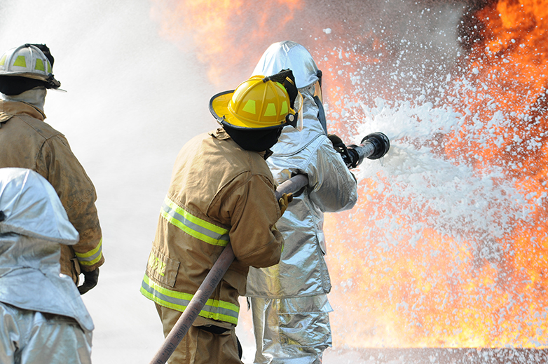 Firefighters use PFAS-containing aqueous film-forming foam (AFFF) to extinguish a blaze.