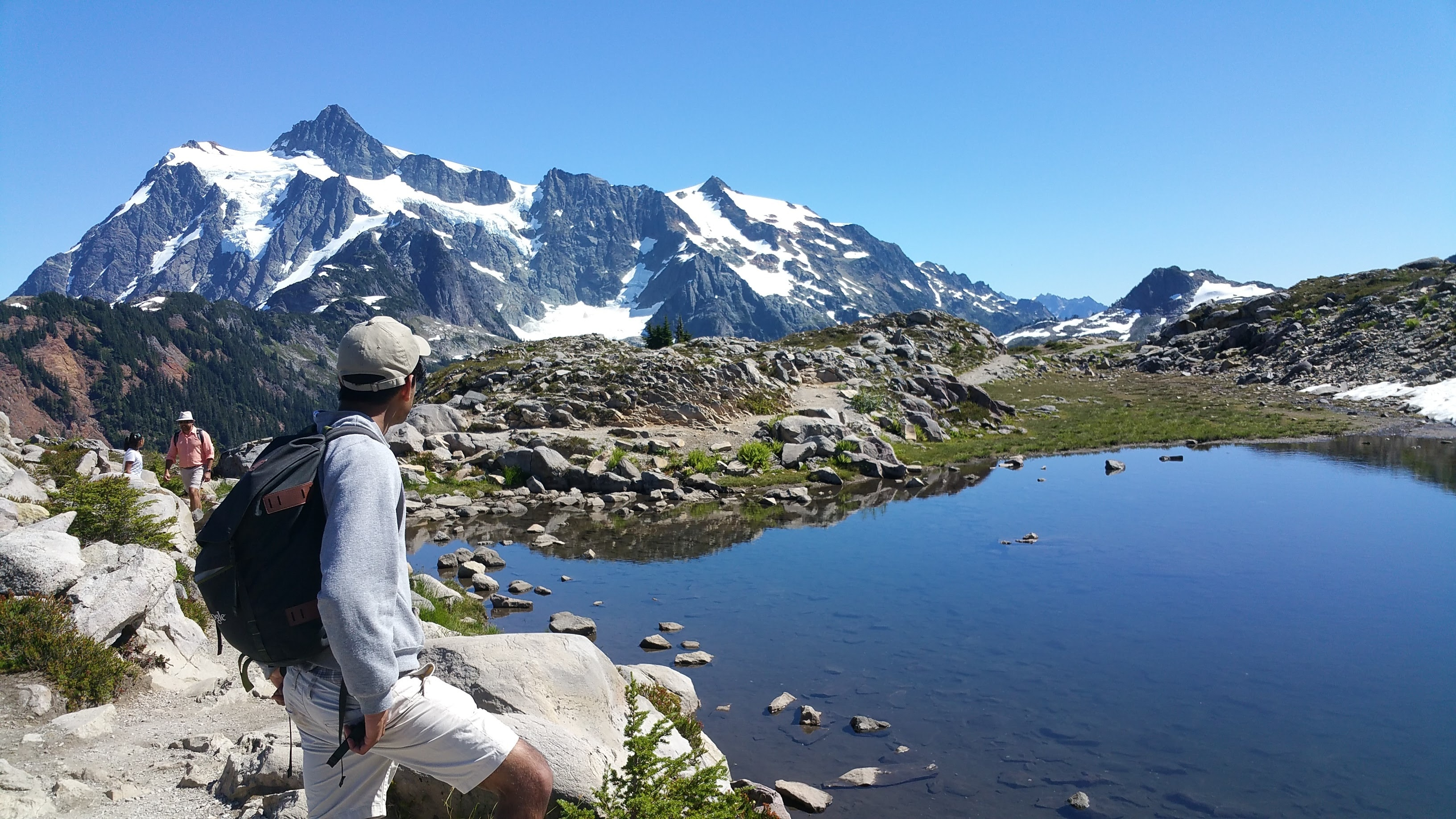 Hiker looks at Mount Shuksan, Washington