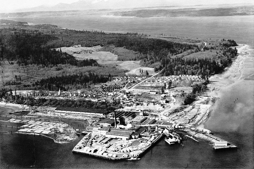 historical photo of mill at Port Gamble, various structures along a shoreline.