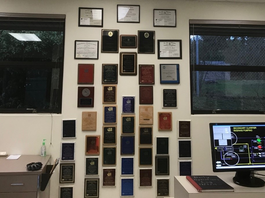 Wall full of awards won by the Port Townsend wastewater treatment plant