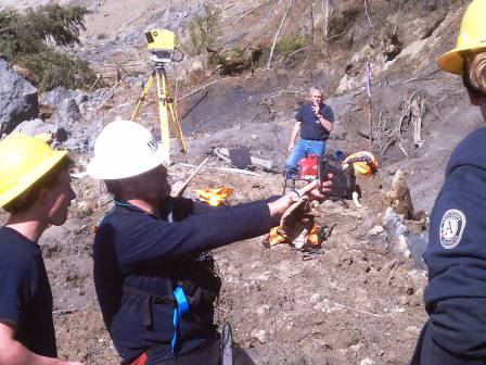 WCC AmeriCorps members survey a landscape using Lidar equipment following a landslide in Oso, Washington.