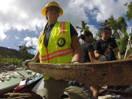 A WCC AmeriCorps member clears rubble from a collapsed building in Saipan.