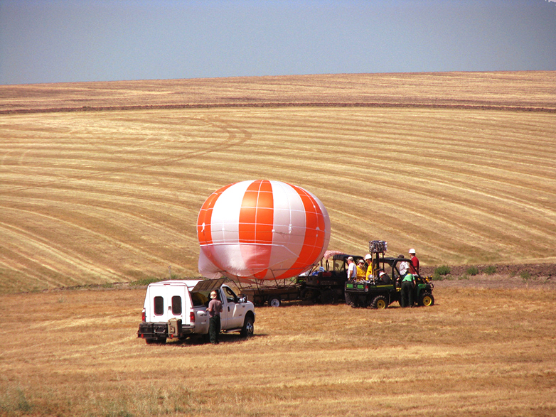 Air balloon being launched with research equipment attached.