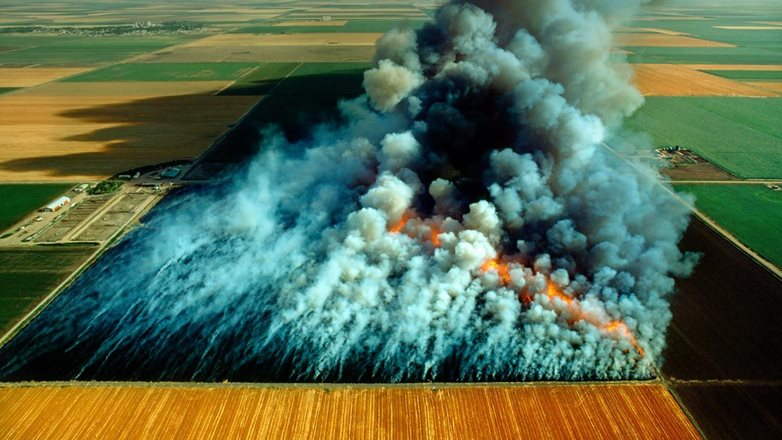 Image of an agricultural burn from the air showing a lot of smoke.