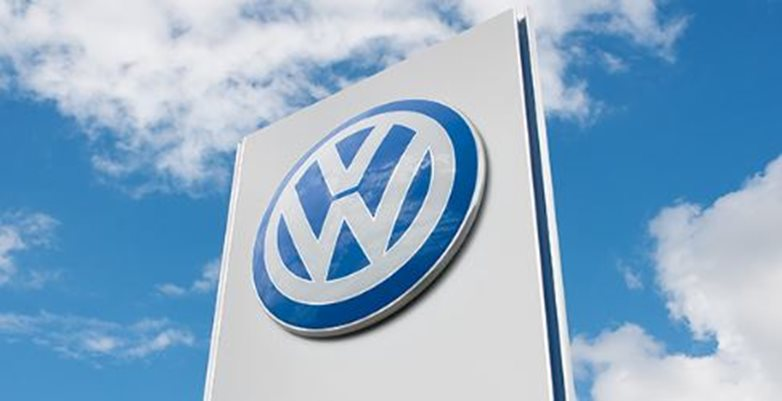 Image of Volkswagen logo and blue sky.