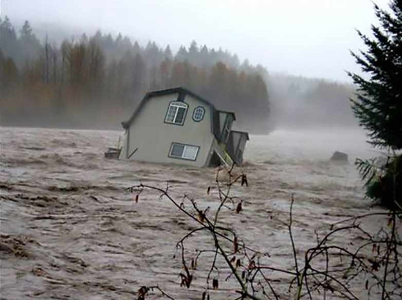 A house washes away in a flood on the Cowlitz river