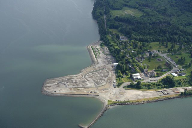 Photo of Port Gamble Bay and Mill site after inwater cleanup completed in January 2017. Shows former lumber mill property with all overwater dock structures and creosoted pilings removed.