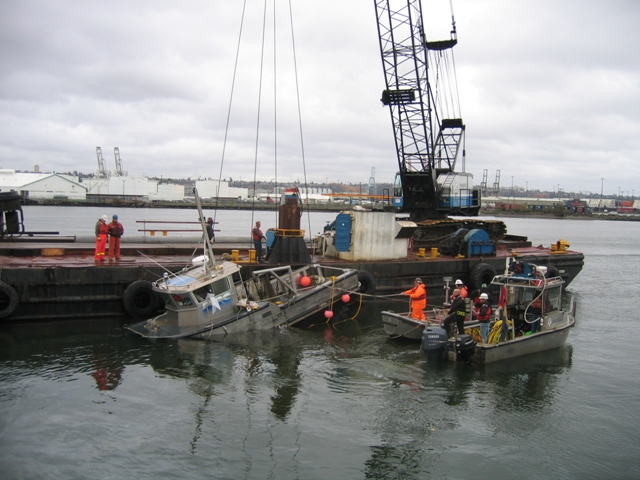 The Sea Boar being raised out of the water.