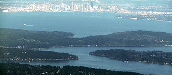 Aerial photo of Puget Sound showing Seattle in the distance.