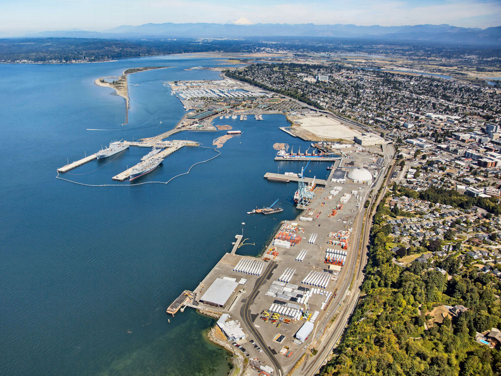 Aerial image of Everett's industrial waterfront looking north from the Port of Everett's South Terminal.  The image shows East Waterway and surrounding industrial properties including Port terminals and Naval Station Everett.