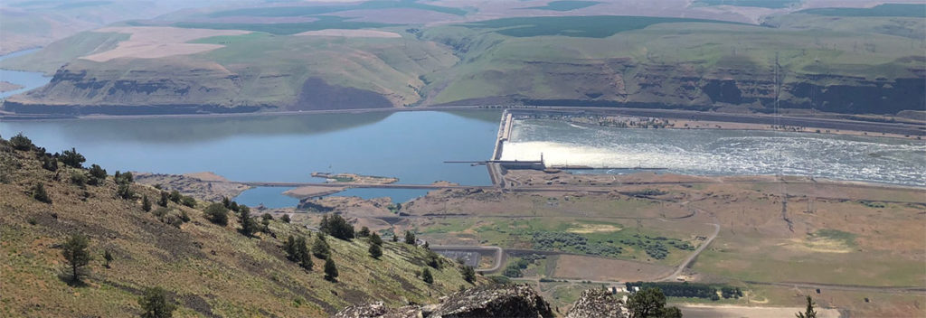 John Day Dam and the Columbia River on a sunny day looking down from the proposed location of the upper reservior.