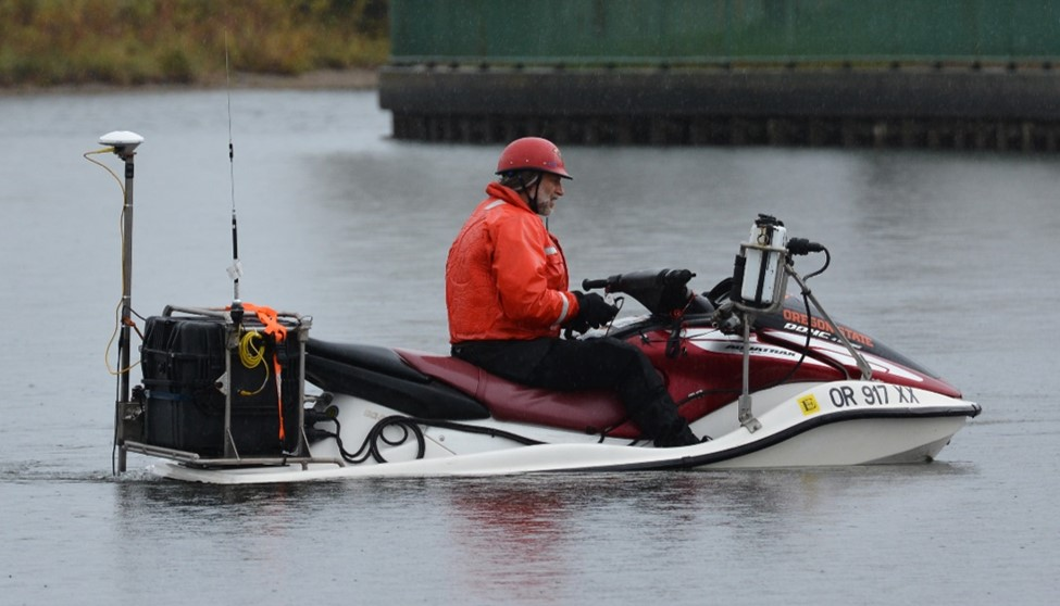 CMAP surveyor collecting data on a personal watercraft mounted with a GPS antenna and single beam sonar.