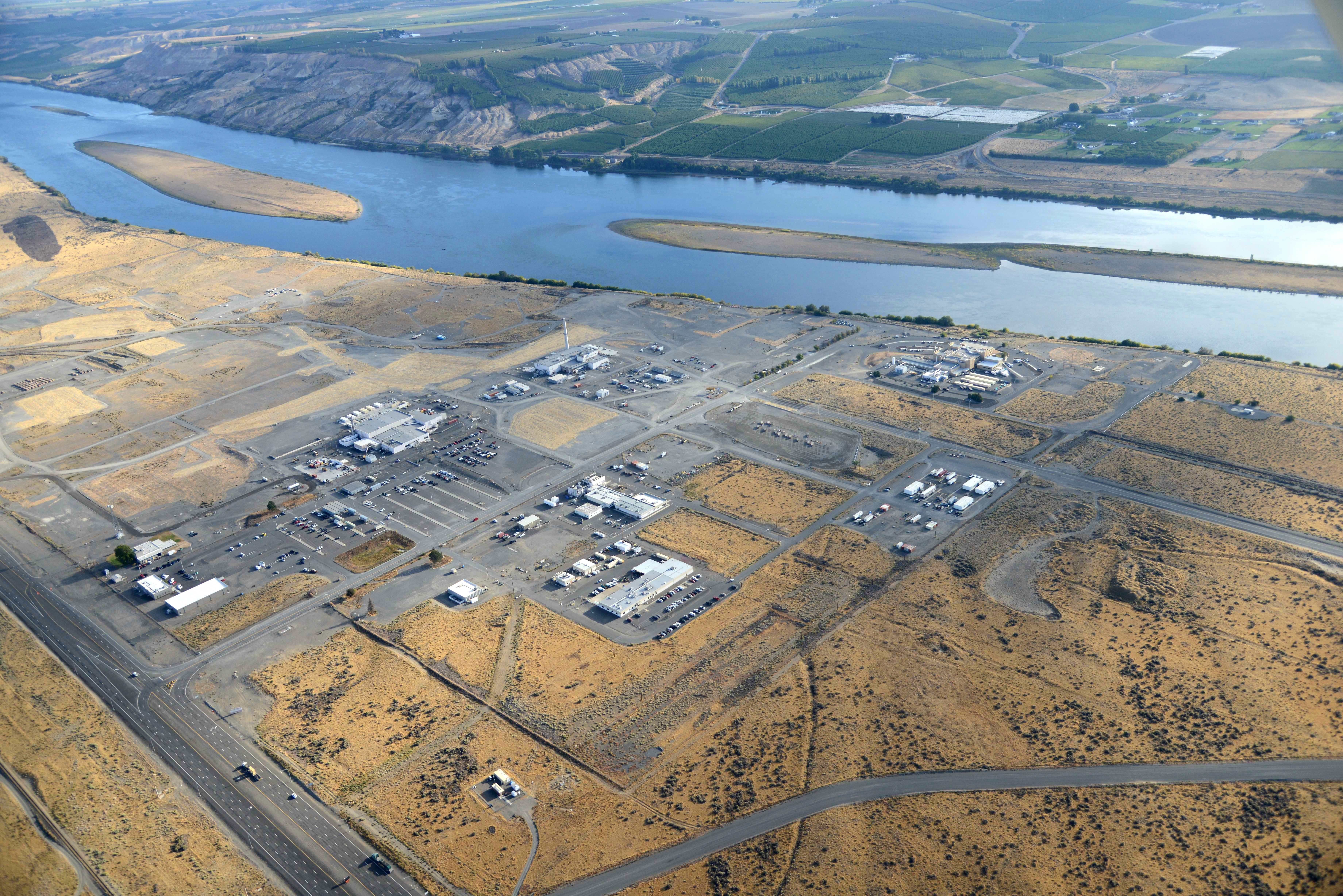 Aerial view of Hanford's 300 Area, showing a variety of buildings spread out over a large swath of land near the Columbia River