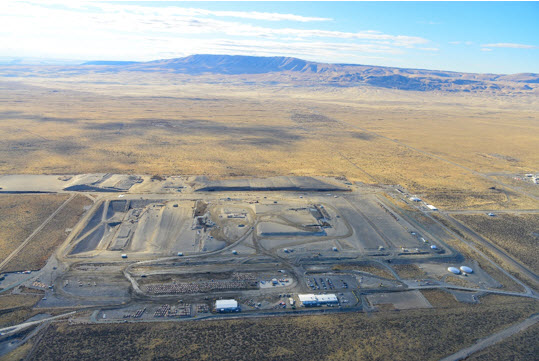 Aerial view of Environmental Restoration Disposal Facility, a massive landfill with various trucks, offices and equipment around it.