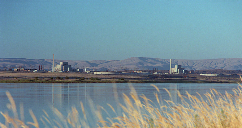 View of Hanford reactors from across the Columbia River.