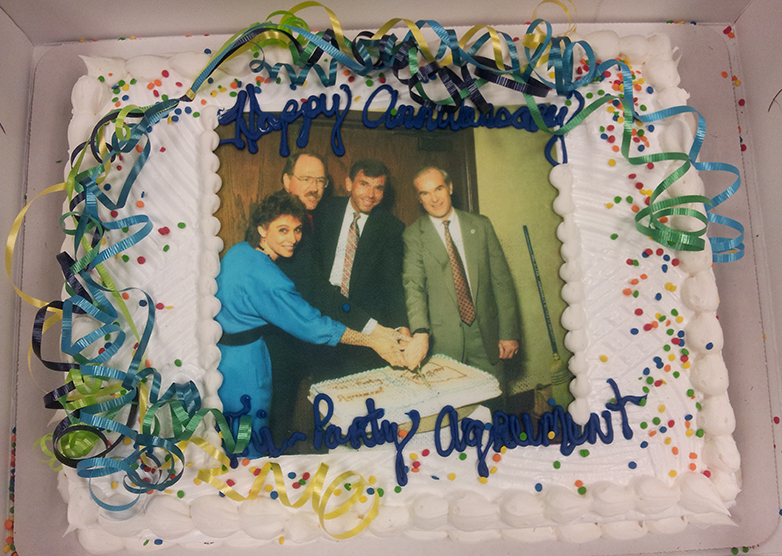 Cake topped with a photo of the original TPA signers