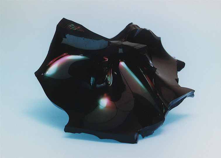 Sample of vitrified glass that is black and shiny.