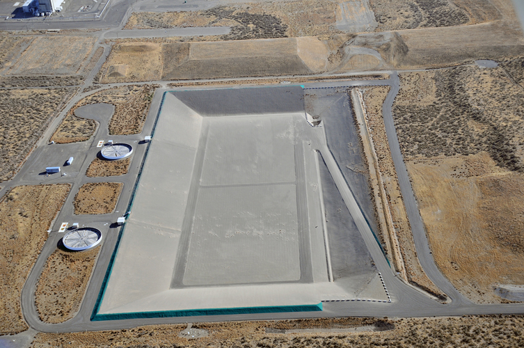 Aerial view of Integrated Disposal Facility, a large, unfilled landfill.
