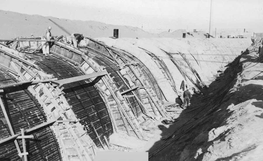 Workers on top of PUREX Tunnel 2 during construction.