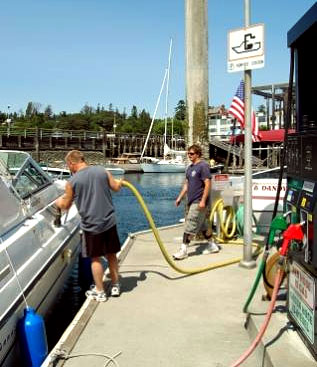 A man using a pumpout station to remove sewage from his boat.