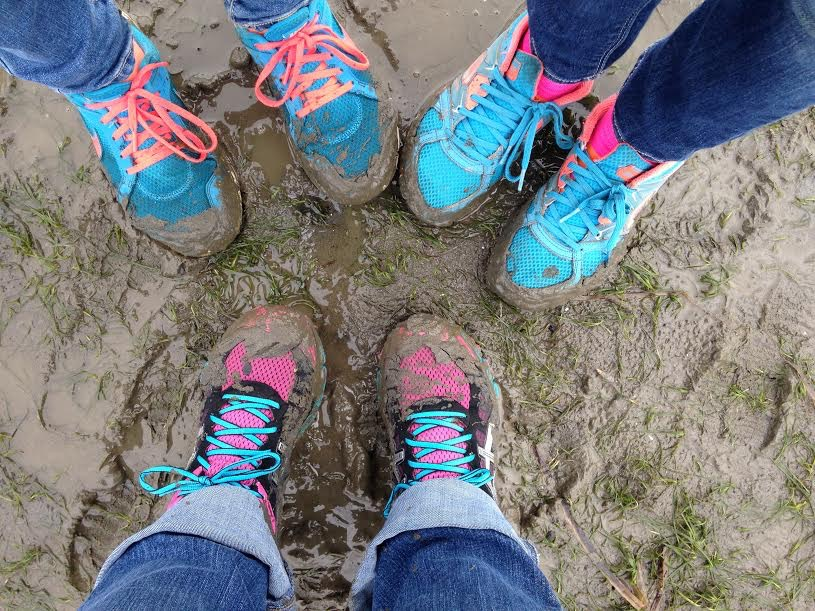 Children with muddy sneakers gather at Padilla Bay.