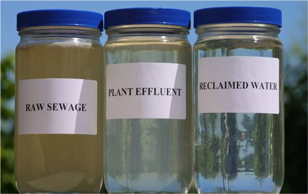 Picture of three bottles of water. Raw Sewage: a cloudy brown liquid.  Treatment Plant Effluent: clear water but with a brown tint. Reclaimed water: clear water.