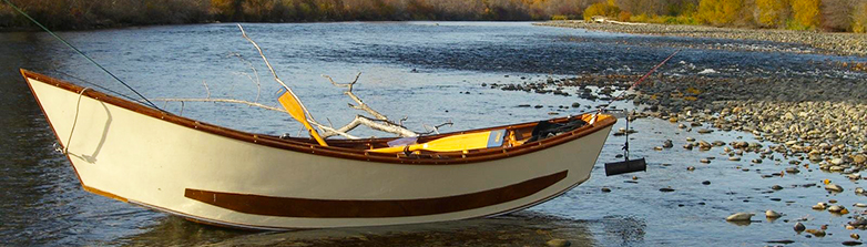 Photo depicts a  closeup view of a drift boat on the Yakima River