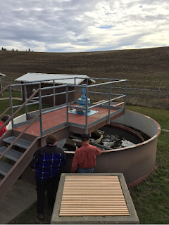 Two people looking into a trickling filter at the Town of Garfield's wastewater treatment plant.