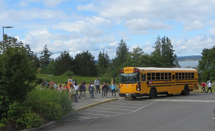 School bus unloading children at Padilla Bay.